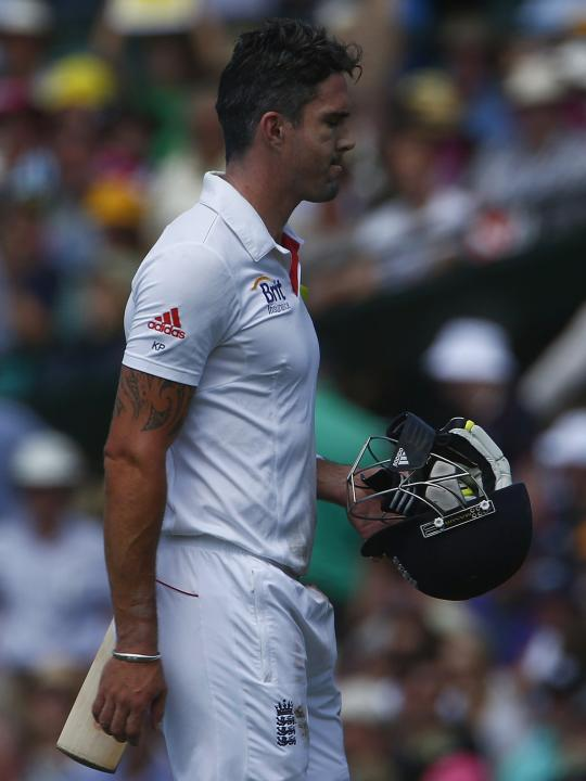 England's Pietersen reacts as he walks off the field after he caught out by Australia's Watson during the second day of the fifth Ashes cricket test at the Sydney cricket ground