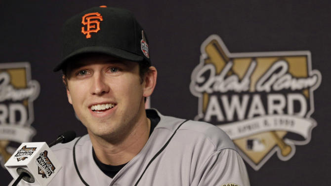 FILE - In this Oct. 27, 2012, file photo, San Francisco Giants catcher Buster Posey talks during a news conference as he receives National League Hank Aaron Award before Game 3 of baseball's World Series against the Detroit Tigers in Detroit. Posey was selected as the National League's Most Valuable Player on Thursda, Nov. 15, 2012. (AP Photo/Patrick Semansky, File)
