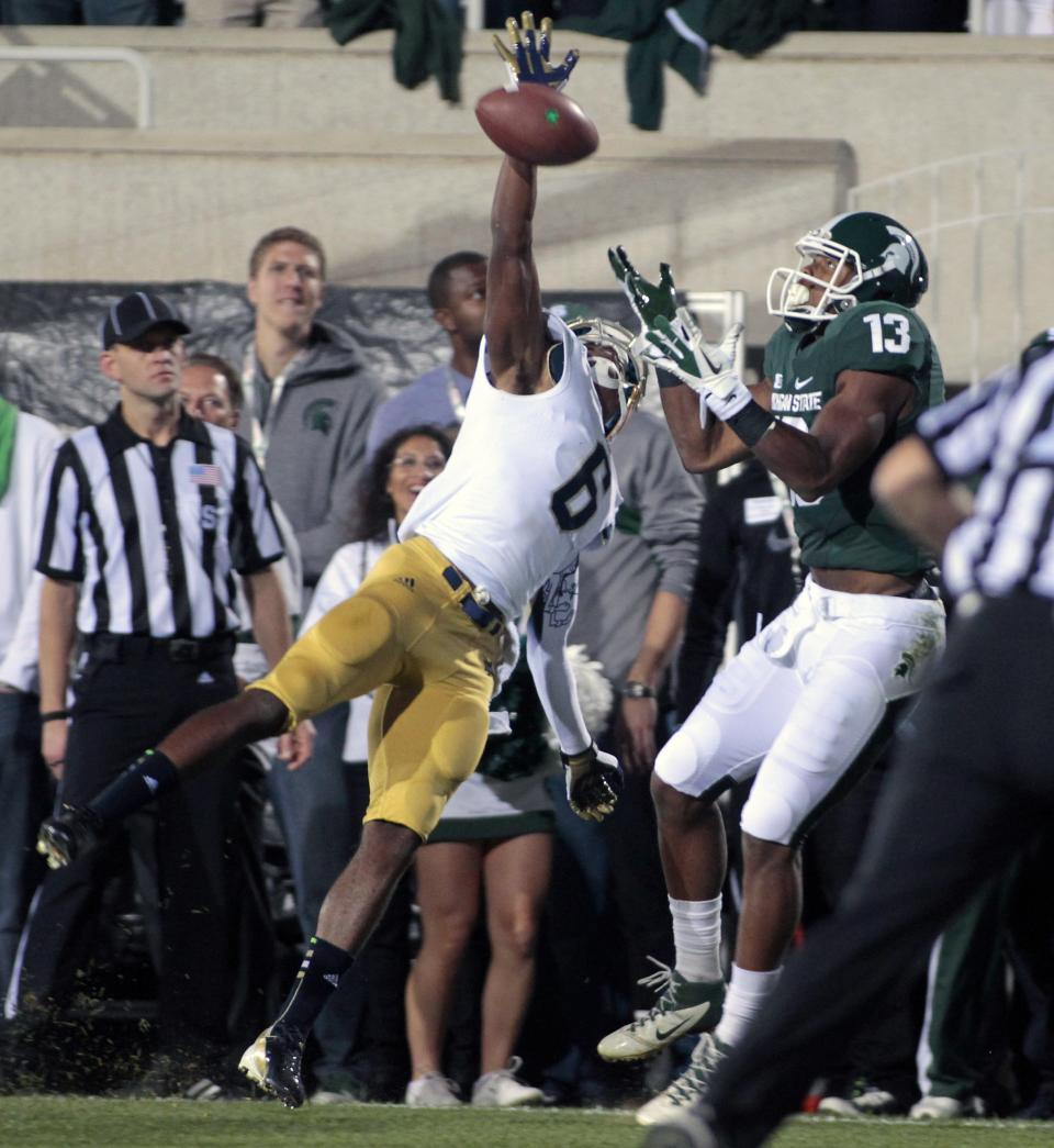 Notre Dame's KeiVarae Russell, left, knocks away a pass in the end zone intended for Michigan State's Bennie Fowler (13) during the first quarter of an NCAA college football game, Saturday, Sept. 15, 2012, in East Lansing, Mich. (AP Photo/Al Goldis)