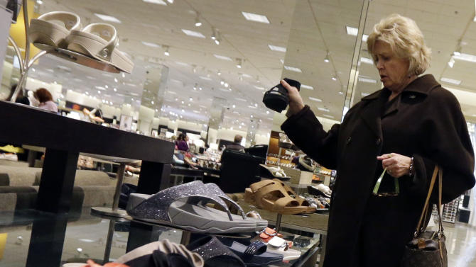 In this Thursday, March 28, 2013, photo, a woman shops at a store in Chicago. The government reports how much consumers spent and earned in March on Monday, April 29, 2013. (AP Photo/Nam Y. Huh)