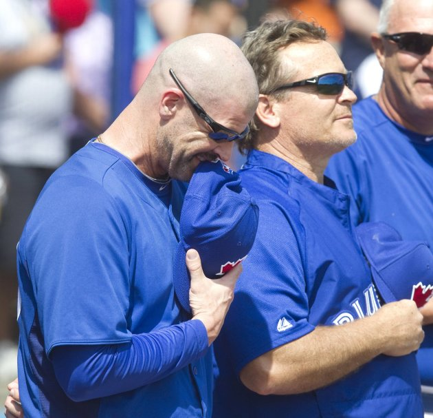 Toronto Blue Jays pitching coach Pete Walker and manager John Gibbons listen to singer Jeff Fuller perform in Dunedin, Florida.