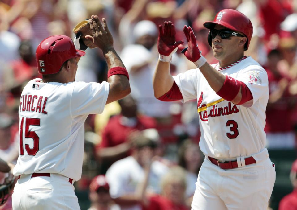 St. Louis Cardinals' Carlos Beltran, right, is congratulated by Rafael Furcal after hitting a three-run home run during the fifth inning of a baseball game against the Philadelphia Phillies, Sunday, May 27, 2012, in St. Louis. (AP Photo/Jeff Roberson)