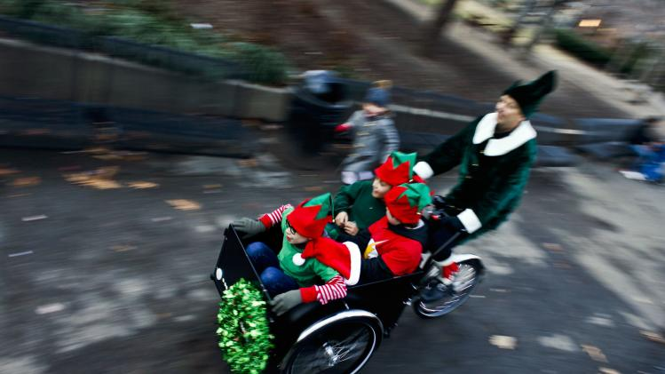 Children enjoy a ride at a local park during Christmas activities in New York