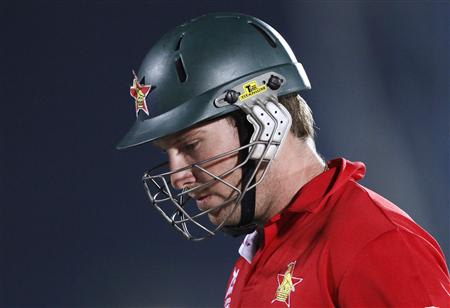 Zimbabwe's Taylor walks off after his dismissal by Sri Lanka's Mendis during their Twenty20 World Cup cricket match in Hambantota