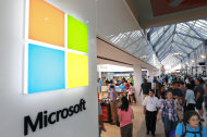 <p> FILE - In this Thursday, Aug. 23, 2012 file photo, the Microsoft Corp. logo, left, is seen on an exterior wall of a new Microsoft store inside the Prudential Center mall, in Boston. Microsoft will use its annual developers conference to release a preview of Windows 8.1, a free update that promises to address some of the gripes people have with the latest version of the company's flagship operating system. The Build conference, which starts Wednesday, June 26, 2013, in San Francisco, will give Microsoft's partners and other technology developers a chance to try out the new system before it becomes available to the general public later in the year. (AP Photo/Steven Senne, File)