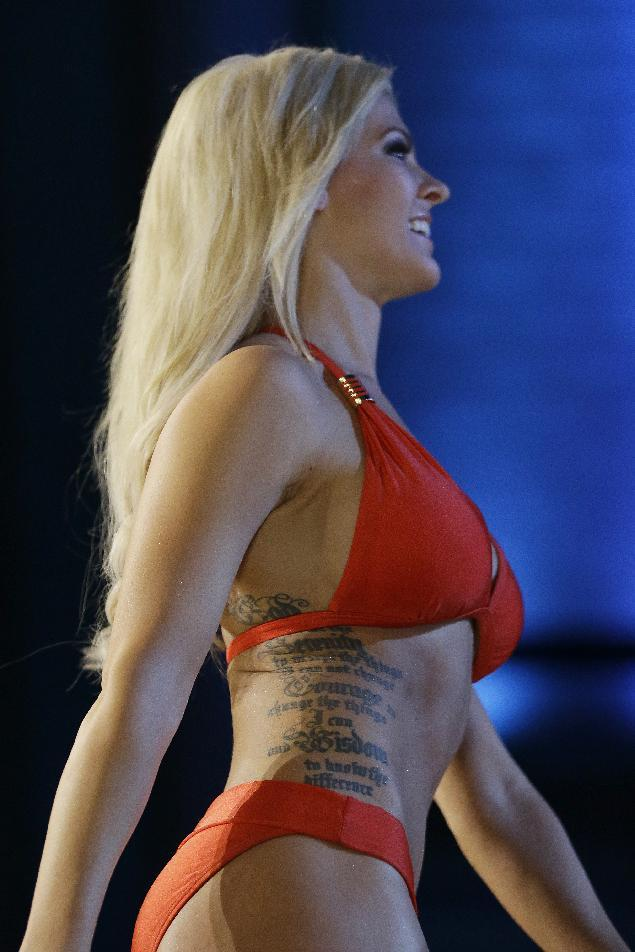 Miss Kansas Theresa Vail shows her bathing suit during the lifestyle competition during the Miss America 2014 pageant, Sunday, Sept. 15, 2013, in Atlantic City, N.J. (AP Photo/Julio Cortez)