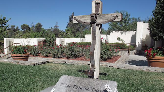 In this photo taken Tuesday Oct, 2, 2012, is the grave site where the Chicano farmworker leader Cesar Chavez is buried in the memorial garden in Keene, Calif. On Monday, President Barack Obama will designate the memorial and other sites on the property where the late farmworker leader once lived and worked as a national monument. Today, the foothills of the Tehachapi mountains continue to house the United Farm Workers of America headquarters and memorials to Chavez, though farmworkers no longer live there. President Obama is designating parts of the property as a national monument and visiting the site on Monday, a move seen as likely to shore up support from Hispanic and progressive voters just five weeks before the election.  (AP Photo/Gosia Wozniacka)