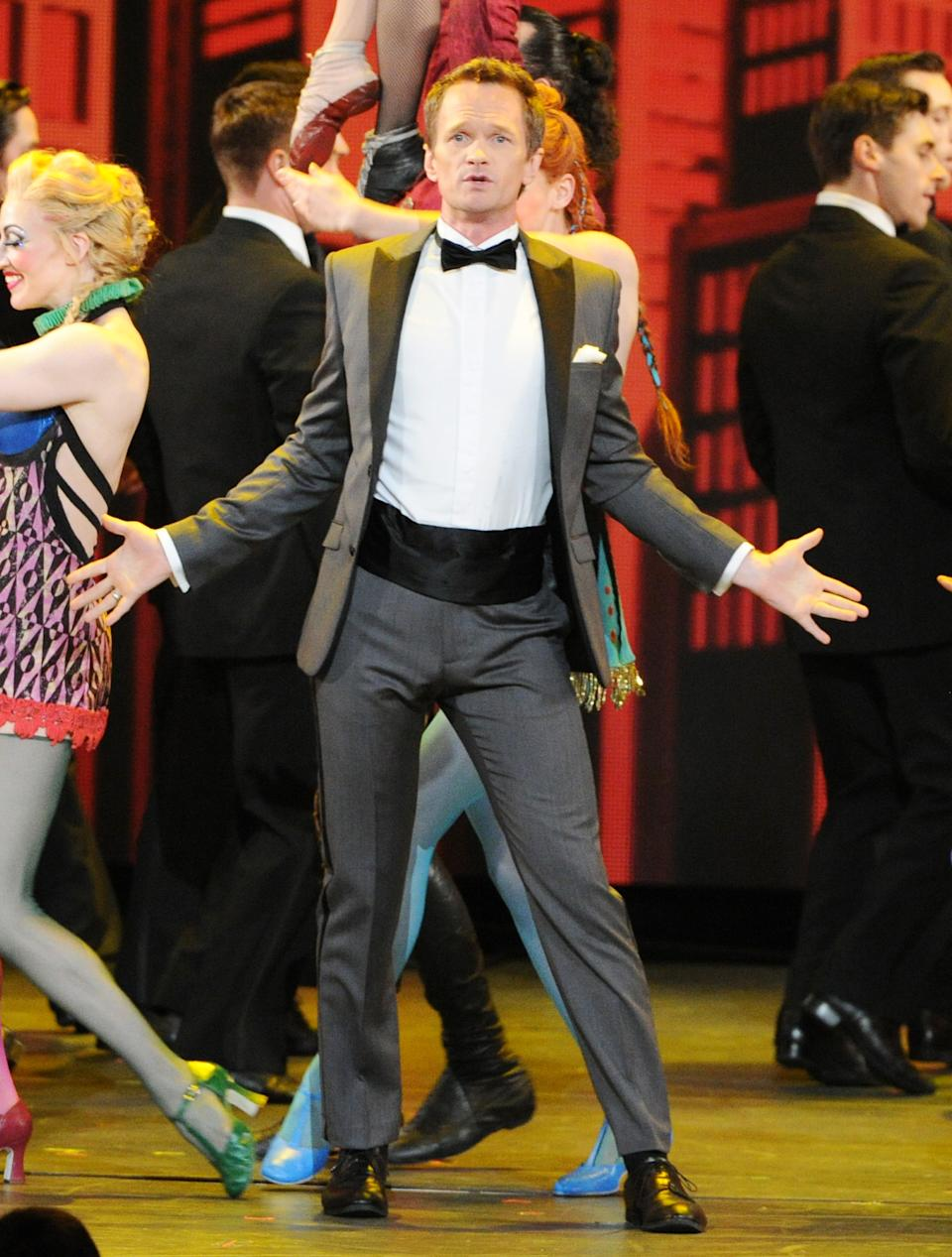 "FILE - This June 9, 2013 file photo shows actor Neil Patrick Harris performing on stage at the 67th Annual Tony Awards in New York. Harris will star in an extremely unconventional Broadway show ""Hedwig and the Angry Inch."" (Photo by Evan Agostini/Invision/AP, File)"