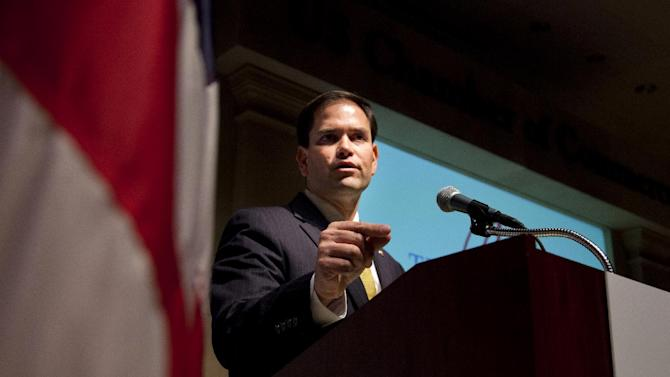 Sen. Marco Rubio, R-Fla. gestures during a speech at the Latino Coalition annual economic summit, Wednesday, May 23, 2012 in Washington, at the U.S. Chamber of Commerce in Washington.  (AP Photo/Evan Vucci)