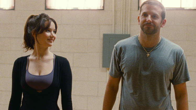 "This film image released by The Weinstein Company shows Jennifer Lawrence, left, and Bradley Cooper in ""Silver Linings Playbook.""The film  was nominated for a Golden Globe for best musical or comedy on Thursday, Dec. 13, 2012. Lawrence was nominated for best actress in a comedy and Cooper was nominated for best actor in a comedy. The 70th annual Golden Globe Awards will be held on Jan. 13.  (AP Photo/The Weinstein Company, JoJo Whilden)"