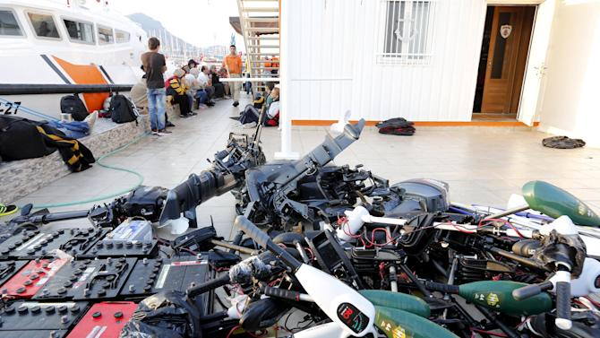 Engines are pictured as migrants wait at a Turkish coast guard station near the resort town of Bodrum