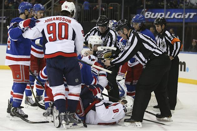 Washington Capitals right wing Alex Ovechkin (8), of Russia, is untangled from a pile at the New York Rangers goal after New York Rangers goalie Henrik Lundqvist (30), of Sweden, makes a save in the f