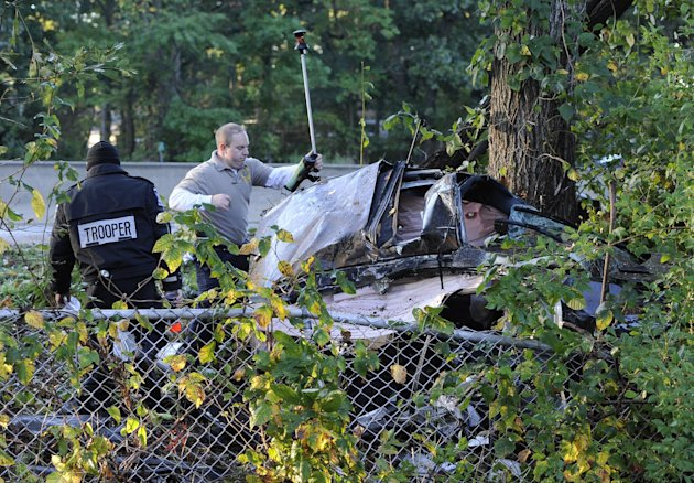 New York State Troopers investigate the scene of car accident that occurred early Monday, Oct. 8, 2012, on the Southern State Parkway westbound near exit 17 Hempstead Avenue on in West Hempstead, N.Y. New York State police say four people were killed in the one-car accident, and a fifth person was taken to a hospital. (AP Photo/Kathy Kmonicek)