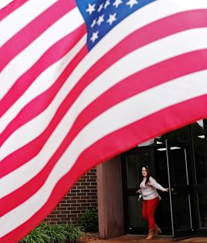 Jaimie Altstiel walks out the doors of Faith Baptist Fellowship in Sioux Falls, S.D., after voting during the South Dakota primary election on Tuesday, June 3, 2014. (AP Photo/Argus Leader, Joe Ahlquist) NO SALES.