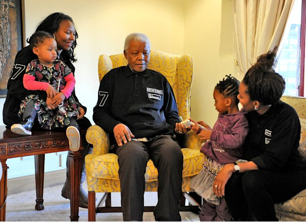 In this hand out photograph supplied by Peter Morey Photographic for the Mandela family, showing former South African president Nelson Mandela, center, with family members left to right Zaziwe Manaway