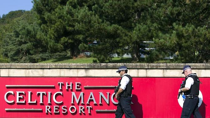 Armed police officers stand guard outside The Celtic Manor Resort, the venue for the upcoming NATO summit, in Newport, south Wales, on September 2, 2014