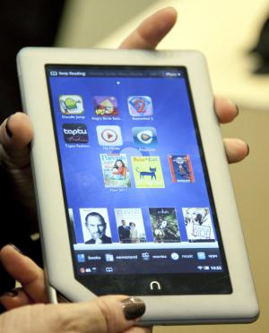 FILE - In this Nov. 7, 2011 file photo provided by Barnes & Noble a demonstrator holds the new Barnes & Noble Nook Tablet following a news conference in New York. Barnes & Noble said Thursday, Jan. 5, 2011, it is reviewing its options for its growing Nook e-book reader business and might spin it off from its core bookstore business. (AP Photo/Barnes & Noble, Jim Sulley, File)
