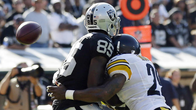 Oakland Raiders wide receiver Darrius Heyward-Bey, left, is hit by Pittsburgh Steelers safety Ryan Mundy during the fourth quarter of an NFL football game in Oakland, Calif., Sunday, Sept. 23, 2012. Heyward-Bey was injured on the play and had to leave the game. He was taken to the hospital with a neck injury after the helmet-to-helmet hit from Mundy who was not penalized. (AP Photo/Marcio Jose Sanchez)