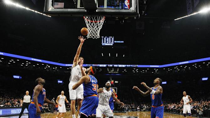 Brooklyn Nets center Brook Lopez (11) shoots over New York Knicks center Rasheed Wallace (36) in the first half of their NBA basketball game at Barclays Center, Monday, Nov. 26, 2012 in New York. The Nets won 96-89 in overtime. (AP Photo/Kathy Willens)