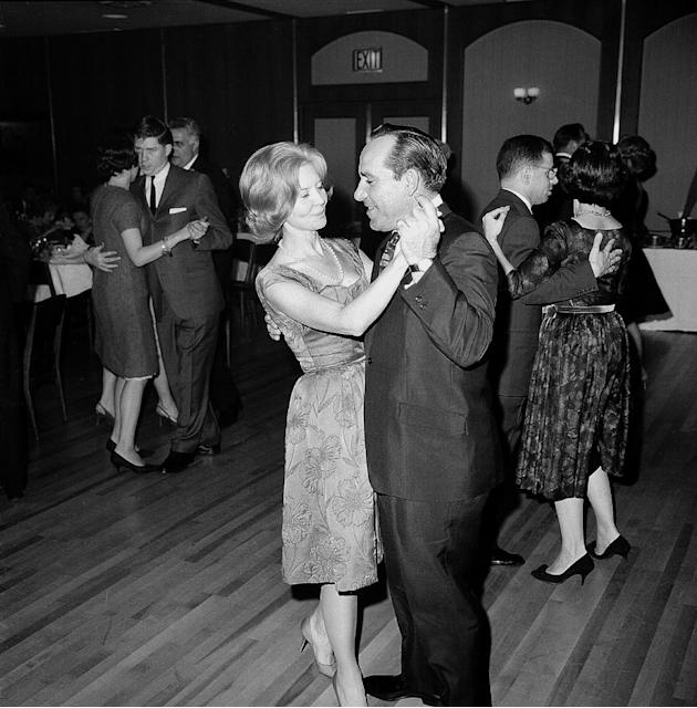 FILE- In this Dec. 13, 1963 file photo, New York Yankees manager Yogi Berra, dances with his wife Carmen at the annual Baseball Writers' dinner in New York City.  According to a report on NJ.com,