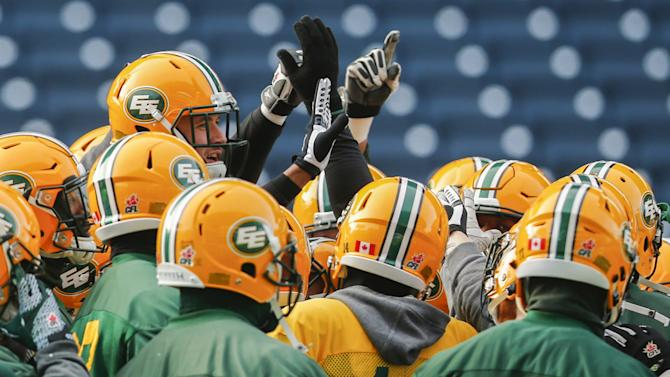 Eskimos players huddle up during their team's practice ahead of the CFL's 103rd Grey cup championship football game in Winnipeg