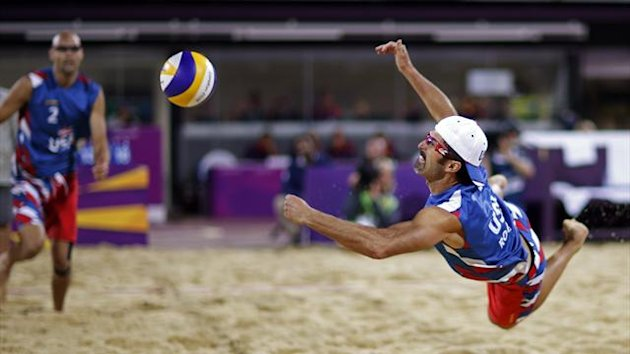 Todd Rogers of the U.S. jumps to try to save the ball as his teammate Phil Dalhausser runs towards him (Reuters)