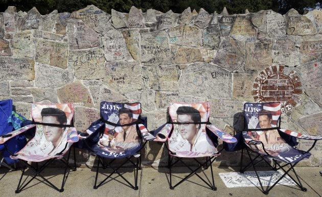 Elvis Presley chairs hold spots for people waiting outside Graceland, Presley&#39;s Memphis, Tenn. home, on Wednesday, Aug. 15, 2012. Fans are lined up to take part in the annual candlelight vigil marking the 35th anniversary of Presley&#39;s death. (AP Photo/Mark Humphrey)