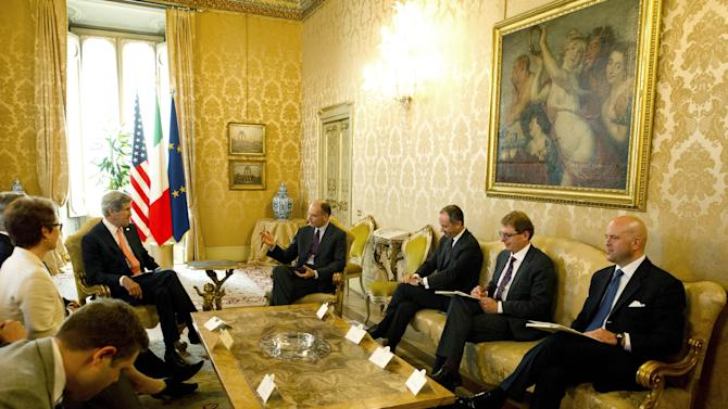 Italian Prime Minister Enrico Letta, centre right, speaks with US Secretary of State John Kerry, 3rd left,  during a meeting  during their meeting at the Palazzo Chigi in Rome on Thursday May 9, 2013. (AP Photo/Mladen Antonov)