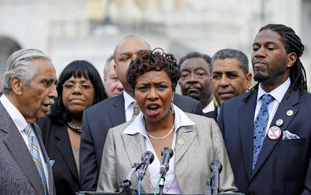 Rep. Yvette D. Clarke, D-N.Y,  center, accompanied by Rep. Charles Rangel, D-N.Y., left, New York City Councilman Jumaane Williams, right, and others, speaks about the New York Police Department's sto
