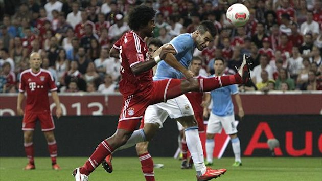 Alvaro Negredo (R) of Manchester City tries to score against Bayern Munich's Dante (Reuters)