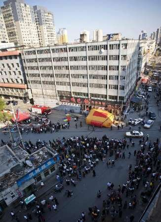Woman in wedding gown attempts to kill herself by jumping out of seven-storey residential building in Changchun