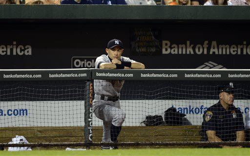 New York Yankees' Ichiro Suzuki, of Japan, looks on from the dugout rail during the fifth inning of a baseball game against the Baltimore Orioles, Tuesday, May 21, 2013, in Baltimore