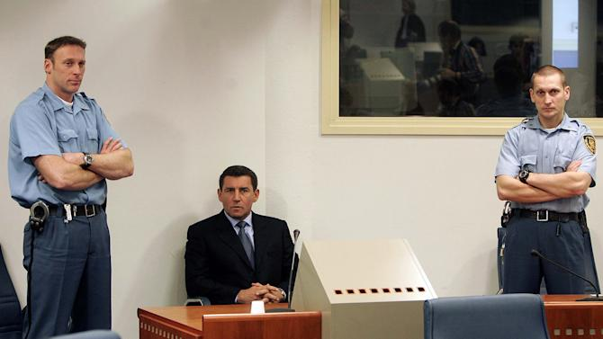 FILE This Monday Dec. 12, 2005 file photo shows former Croatian General Ante Gotovina, center,  during his initial appearance at the courtroom of the Yugoslav war crimes tribunal in The Hague, the Netherlands. Thousands of Croatians are attending Masses and candlelight vigils for their hero, Gen. Ante Gotovina, as they anxiously await the outcome of his appeal Friday Nov. 15, 2012 against a war crimes verdict at a U.N. tribunal. Gotovina and Gen. Mladen Markac were last year sentenced to 24 and 18 years in jail respectively for war crimes against minority Serbs during a 1995 military offensive that retook the land held by the rebels. Some 600 Serbs were killed and more than 200,000 were driven from their homes during the operation.  (AP Photo/Ed Oudenaarden, Pool)