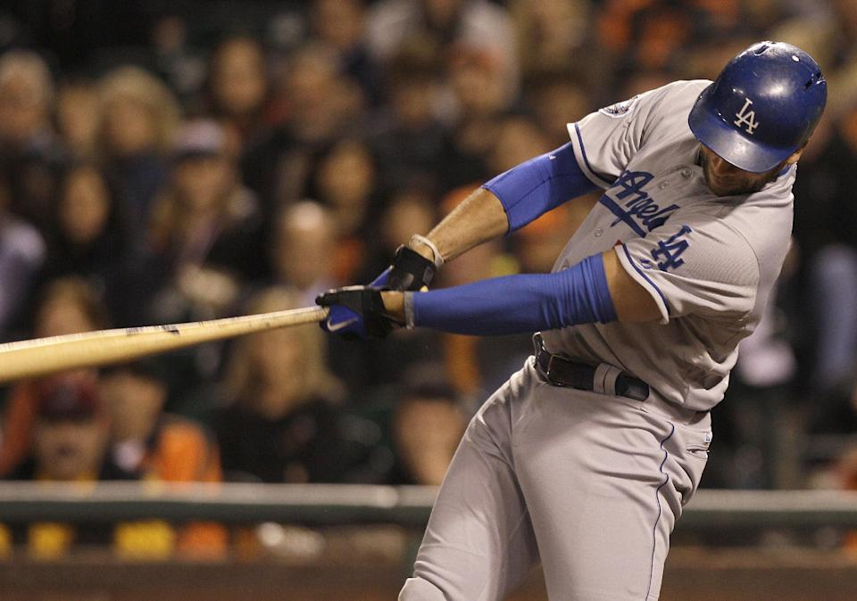 Los Angeles Dodgers' James Loney singles off of San Francisco Giants pitcher Matt Cain to score Andre Ethier during the sixth inning of a baseball game in San Francisco, Friday, July 27, 2012. (AP Photo/Jeff Chiu)