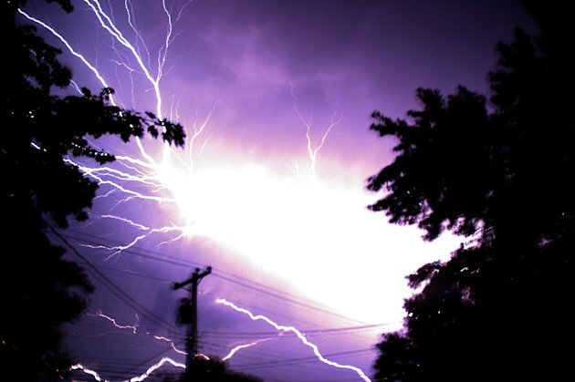 Lighting flashes Saturday morning, June, 30, 2012 in Hebron Md.. Violent storms swept across the eastern U.S., killing at least nine people and knocking out power to hundreds of thousands on a day tha