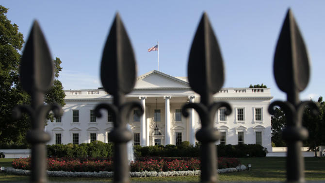 The White House is seen through an iron fence, Saturday, July 30, 2011 in Washington, as the debt crisis remains unresolved. (AP Photo/Carolyn Kaster)