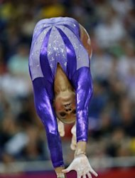 US gymnast Gabrielle Douglas performs on the beam during the women's qualification of the artistic gymnastics event of the London Olympic Games at the 02 North Greenwich Arena in London