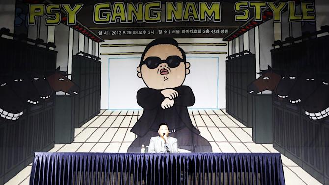 "FILE - In this Sept. 25, 2012, file photo, South Korean rapper PSY, who sings the popular ""Gangnam Style"" song, answers reporters' question during a press conference in Seoul, South Korea. In Google's 12th annual roundup of trending searches, PSY's ""Gangnam Style"" music video trotted into second spot in 2012, a testament to his self-deprecating giddy-up dance move. (AP Photo/Lee Jin-man, File)"