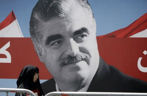 A Muslim woman walks past a portrait of slain Lebanese former premier Rafiq Hariri in Beirut in 2011. A UN-backed court said Thursday it had set a provisional date in March next year to begin a trial over the 2005 bomb attack that killed Hariri