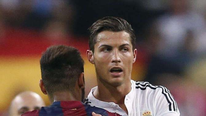 """Real Madrid's Ronaldo embraces Barcelona's Neymar after their Spanish first division """"Clasico"""" soccer match at the Santiago Bernabeu stadium in Madrid"""