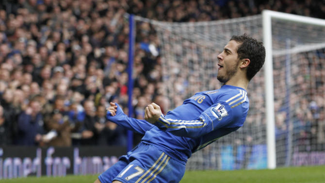 Chelsea's Eden Hazard celebrates his goal against West Ham United during their English Premier League soccer match at Stamford Bridge, London, Sunday, March 17, 2013. (AP Photo/Sang Tan)