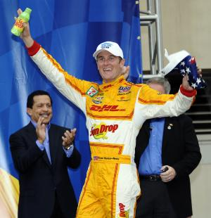 Ryan Hunter-Reay celebrates in victory lane after winning the IZOD IndyCar Grand Prix of Baltimore auto race, Sunday, Sept. 2, 2012, in Baltimore. (AP Photo/Nick Wass)