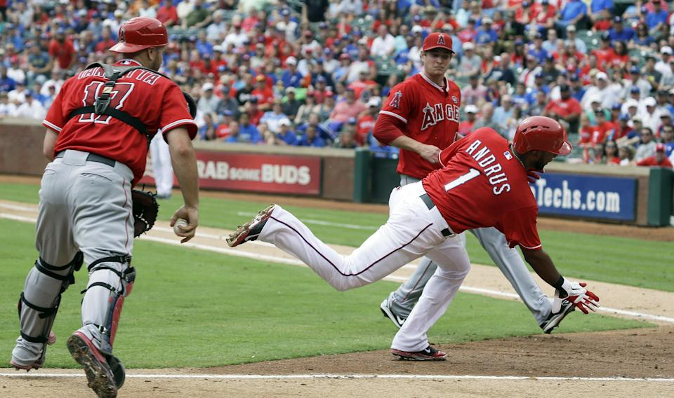 Rangers beat Angels 7-4, still in playoff chase