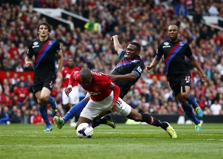 Manchester United's Young is fouled by Crystal Palace's Dikgacoi during their English Premier League soccer match at Old Trafford in Manchester, northern England
