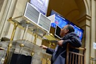 <p>A trader looks at the IBEX-35 index billboard on Monday at Madrid's stock exchange. European leaders face difficult decisions in the days ahead on managing the outcome of the Greek election, upholding their credibility on financial discipline to avoid stoking contagion, and making convincing progress towards a grand plan for deeper integration.</p>