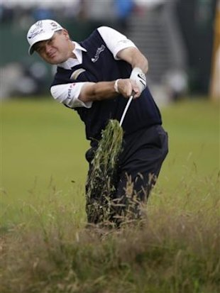 Paul Lawrie of Scotland plays out of rough on 7th fairway at Royal Lytham &amp;#38; St Annes golf club during the first round of the British Open Golf Champio