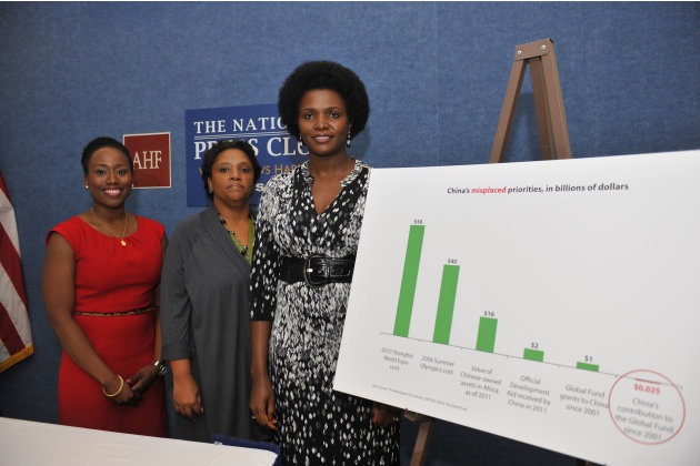 IMAGE DISTRIBUTED FOR AIDS HEALTHCARE FOUNDATION - Left to right, Omonigho Ufomata, Jenny Boyce and Dr. Penninah Amor, several of the AIDS patients, doctors and advocates from around the world affilia
