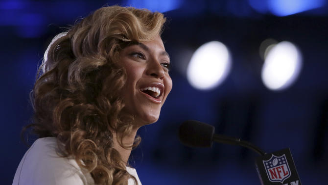 Beyonce answers questions during an NFL football Super Bowl XLVII news conference at the New Orleans Convention Center, Thursday, Jan. 31, 2013. in New Orleans. (AP Photo/J. David Ake)