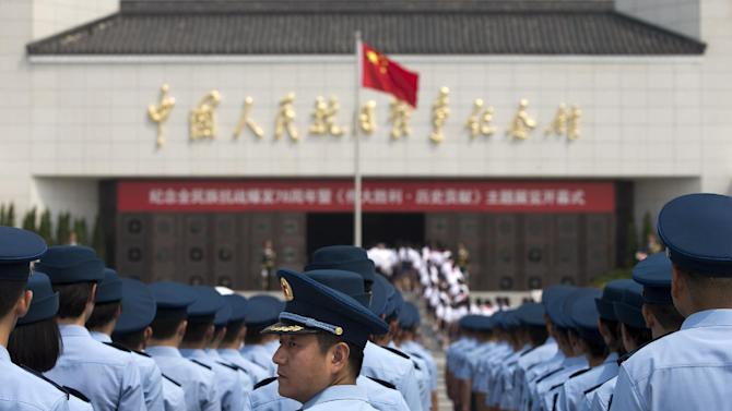 """Soldiers from the People's Liberation Army (PLA) Air Force division stand in lines during the opening ceremony of the Museum of the War of Chinese People's Resistance Against Japanese Aggression commemorating the World War II victory over Japan, in Beijing Tuesday, July 7, 2015. Soldiers and children stood in silence outside the museum at the opening ceremony for the """"Great Victory and Historical Contribution"""" exhibition on the 78th anniversary of the Marco Polo Bridge Incident. A clash at the Marco Polo Bridge in 1937 is regarded as the first battle of the second Sino-Japanese war, which lasted until Japan's defeat by the Allies in 1945. (AP Photo/Andy Wong)"""