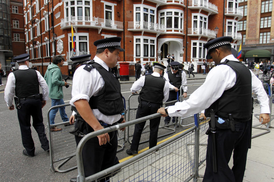 British police officers place barriers outside the Ecuadorian Embassy in central London, London, Thursday, Aug. 16, 2012. WikiLeaks founder Julian Assange entered the embassy in June in an attempt to gain political asylum to prevent him from being extradited to Sweden, where he faces allegations of sex crimes, which he denies. (AP Photo/Sang Tan)